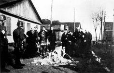 Radzyn, Poland, Jews forced by German policemen to burn books.
