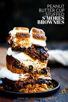There's no campfire needed for these Peanut Butter Cup Stuffed S'mores Brownies! A graham cracker crust base is topped with a rich brownie batter, peanut butter cups, candy bar and large jet-puffed marshmallows. Decadent and delicious! #smores #brownies #peanutbutter #marshmallows #desserts #dessertfoodrecipes