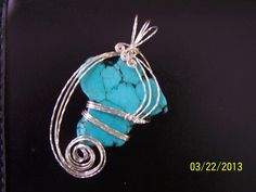 Imitation turquoise (dyed howlite), wrapped in sterling silver