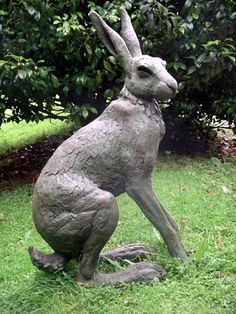 Bronze resin Rabbits and Hares #sculpture by #sculptor Lucy Kinsella titled: 'Seated Hare (Large Bronze resin Garden Sculptures)' #art