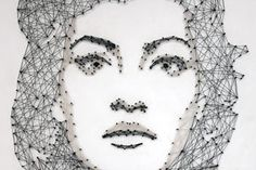 Pamela Campagna creates portraits by putting nails into a wooden board and then using thread to create the figurative elements of the face and body.