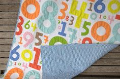 Think I'm going to design my own numbers fabric and have it printed at Spoonflower to make this. It's awesome.