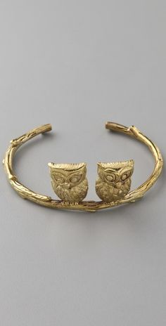 Brass cuff with two owls sitting on a textured branch by Monserat D Lucca