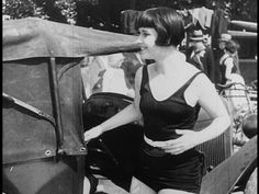 Luciene (Louise Brooks) dressing for the beach in the opening scene of 'Prix de Beaute', 1930.
