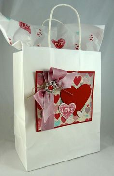 by Michelle Surette, I Stamped That  I like the idea of the bag being decorated by the card