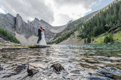 Eloping at a Lake Agnes wedding, hiking in to marry on the alpine lakeshore in the mountains near Lake Louise. Photo by one-edition.ca.