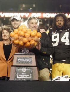 Iowa coach Kirk Ferentz stands with Ricky Stanzi, left, and Adrian Clayborn, right, after the 2010 Orange Bowl victory. (Matthew Holst/Iowa City Press-Citizen)