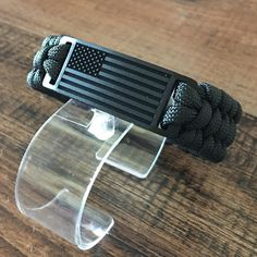 Show your support. Rep the USA with this black ops edition Engraved USA Flag Paracord Bracelet. Exclusively available at @flagstiffy link in bio. www.flagstiffy.com