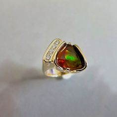 One of a kind fire agate and diamond ring by Glenn Dizon Designs