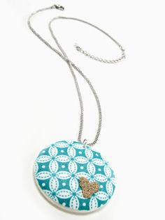 fabric pendent. this i think i'll try; so many options because i can use any fabric i want. this is exactly that kind of project i need for those fabric scraps i have.
