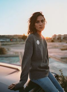 Alexa Chung looking moody (and awesome) in a sweater.