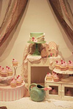 Shabby Chic & Rustic Wedding Cupcake Dessert Table - Wedding Dessert Table. Rustic Chic, Pale pink, green, ivory, burlap, etc. Vintage fabrics, ribbons, found materials. Jadeite, modern and antique pedestals.  Chocolate Cake with Frangelico Italian Meringue Buttercream,  Red Velvet Cake with Cream Cheese Buttercream, and Lemon Zest Cake with Raspberry Buttercream. Cake is Chocolate with Frangelico Buttercream with Italian buttercream, decorated with fondant,