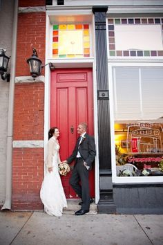 Couple by the red door