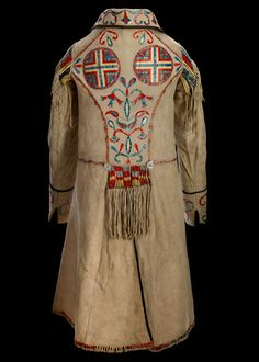 1874  Red River  Hide, mother of pearl buttons, silk ribbon, porcupine quill, dyes  116 x 97 cm
