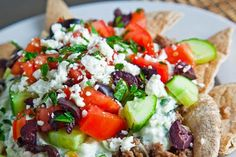 greek nachos! what a fun alternative. mine would be minus the ground anything, but hummus may be a nice substitute...