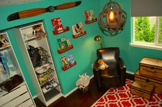 Fun vintage travel and airplane accents in this turquoise nursery!