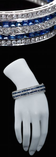 Identical Pair of Art Deco Sapphire Diamond Bangles, A pair of Art deco bangles with Old European cut diamonds and square step cut sapphires as a alternating traight line design. Contains approximately 40cts diamonds and 30cts of sapphires. USA Art Deco.