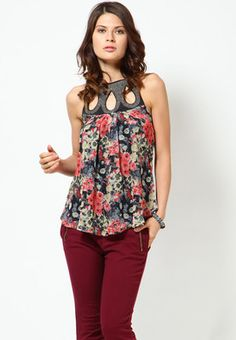 Pink coloured, printed top for women by Species. Made from georgette, this waist-length top features a halter neck. It is sleeveless.