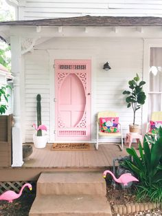 This colorful home has a gorgeous pink front door. The open plan layout isn't overwhelming and the living room rug is just the right amount of bright and colorful without being garish. We love the gallery wall of portraits in the dining room and the patterned wallpaper in the bedroom.