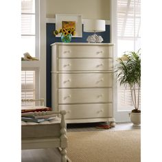 Add this chest to your bedroom decor for a classic cottage look. The chest's shaped front and bun feet give the piece casual coastal charm, while five drawers deliver great storage. A White finish completes the coastal cottage look with a touch of vintage flair.