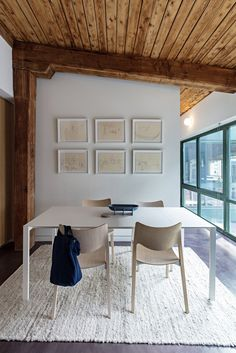 The couple have decorated with framed sketches from a book by Alexander Calder, seen here over the dining table.