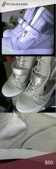 J.Lo: Silver micro fabric platform sneaker 10 J.Lo: silver..on silver micro fabric platform sneaker size 10 zip & lace up. Worn once. Has blk smug on inner step right foot. Jennifer Lopez Shoes Wedges