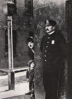 "Charlie Chaplin, Jackie Coogan and Tom Wilson in ""The Kid"", ca. 1921. °"