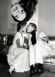 bianca jagger and halston in front of an andy warhol painting of bianca's face