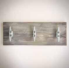 Handcrafted Weathered Wood Boat / Dock Cleat Plank Sign - Cloud Gray - Distressed Rustic Nautical DIY Wooden Towel Rack - Key Holder - Hooks  Cloud Gray. Please visit our shop for all color options:  Rustic Bright White Faded White Wash Seaglass (Teal/Turquoise) Denim (Dark Navy Blue) Faded Denim (Light/Gray Navy Blue) Cloud Gray Blue Slate Jolly Red Natural Wood  No two designs are identical. Can be customized in numerous ways: size, finish, # of cleats, mounting technique, etc. Sold…