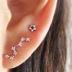Trepador de la oreja de plata de la constelación oído sobre