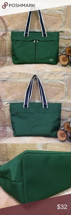 Lacoste Tote/Purse Bag Classic Lacoste brand tote. Two outer pockets and two inner pockets along with a clasp for keys. Green with navy and white straps. Corners are slightly worn, picture 3. Small ink stain inside, picture 4. In good used condition. 19 L x 11 W Lacoste Bags Totes