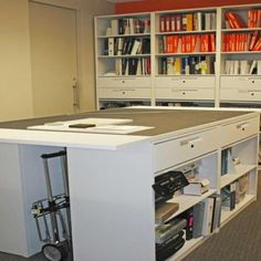 4 Post Shelving at Architectural Firm Business Office Storage Solutions Office Storage Cabinets Architectural Resource Library Storage Strat...