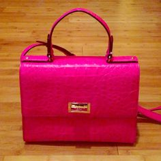Kate Spade Handbag with dust bag. With the new handbag smell still intact. This beautiful bright pink Kate Spade bag is a statement piece with any outfit. kate spade Bags