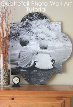 Quatrefoil Photo Wall Art {Tutorial} This is quite a lot of work but a pretty spectacular finished product.