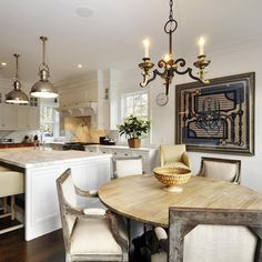 East Hampton .. An Antique iron light fixture and a Framed Hermes scarf bring interest into a new kitchen ..