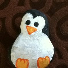 A rock painted like a penguin