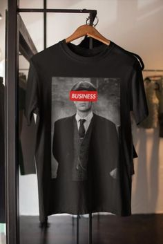 Thomas Shelby Tshirt is only for the Biggest Peaky Blinders Tv Series Fan.Tommy is the main character.The Shelby Brothers are a gang looking to build and Empire. Show your support for the Shelby Brothers as they establish their empire in Birmingham 1919. By order of the Peaky Blinders! Peaky Blinders shirt/ Thomas Shelby tshirt/ Peaky Blinders Tv Series t shirt/ By order of the Peaky Blinders/Tommy Gang/ Money Tee/ Shelby! peaky blinders shirt thomas shelby peaky blinders peaky blinders Peaky Blinders Gifts, Peaky Blinders Tv Series, Valentines Day For Boyfriend, Birthday Cards For Boyfriend, Shelby Brothers, Memories Photo Album, Anniversary Gifts For Husband, Wedding Photo Albums, Business Shirts