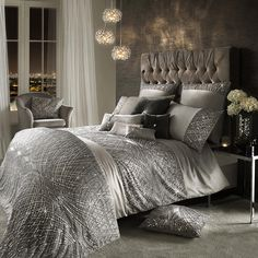 Instantly refresh a bedroom interior with this Esta Silver duvet cover from Kylie Minogue. Adding sparkle and glamour to a home, this silver duvet cover features a statement beaded design and a soft s