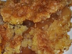 Caramel Apple Dump cake recipe with 4 ingredients ~Instructions 1.In a greased 9x13 dish, mix apple pie filling and caramel sauce.  2.You may add in the 1/2 tsp cinnamon if desired.  3.Spread evenly in pan.  4.Pour dry cake mix directly on top of the pie filing and spread evenly.  5.Top with melted butter and pecans (optional).  6.Bake at 350 degrees for 45-50 minutes or until top is golden brown and apple filling is bubbly around the edges.  7.Serve with ice cream or whipped cream.  8.Enjoy!