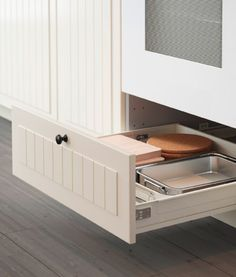 Open drawer placed under oven