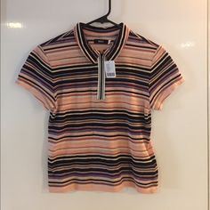 BDG Joni Polo UO W/Tags Never worn! Out of stock! Purchased from Urban Outfitters. Very vintage/70's looking. Can't seem to pull it off so want someone else to love this amazing shirt. I usually wear small/medium tops and the large fits nicely. Very slight cropped top. Looking to make money back so please don't low ball on offers Urban Outfitters Tops