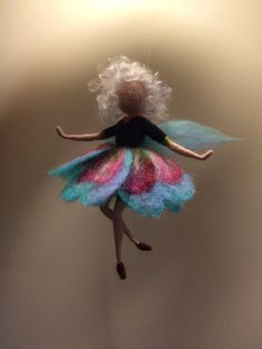This is one of my magical flower fairy. I called her Pansy because her dress resembles this flower. She is light, flying, dancing . Her hair has light brown color and made of the bamboo fiber. The height is cm). Wool Dolls, Felt Dolls, Needle Felted Animals, Felt Animals, Felt Crafts, Fabric Crafts, Felt Angel, Needle Felting Tutorials, Felt Fairy