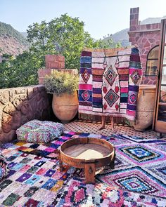 Creating an outdoor lounge area with Moroccan Boucherouite rugs.