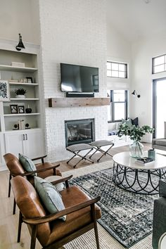 Brown mid-century leather chairs in Farmhouse