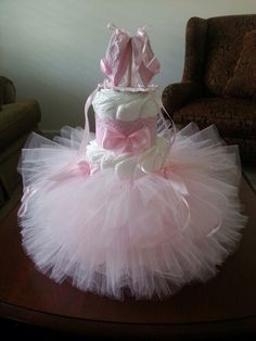 Three Tier Ballerina Diaper Cake / Ballerina Baby Shower / TuTu Diaper Cake / TuTu Baby Shower / Shower Centerpiece by TheCarriageShoppe on Etsy https://www.etsy.com/listing/202338606/three-tier-ballerina-diaper-cake