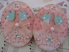 handmade Easter Egg Embellishments ... luv the doily decoration pearls & jewels ... organza bow ... glitter paper tulips ... gorgeous!