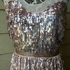 Stunning French Connection Dress Stunning sequin and beaded French Connection dress with sheer accents and low v shaped back. Size 6. French Connection Dresses Midi