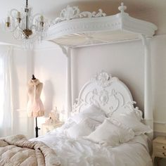 French bedroom in faded whites