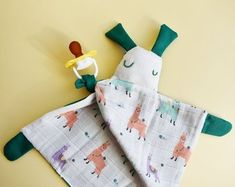 Modern baby kids and humorous grown ups accessories. by Zezling Baby Lovey, Baby Bibs, Sleeping Bunny, Pram Toys, Dribble Bibs, Pacifier Holder, Baby Alpaca, Soft Dolls, Newborn Gifts