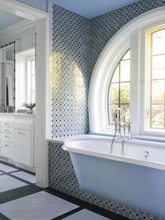 I love how this tub is mounted into the wall with great tile by Austin Patterson Disston Architects: